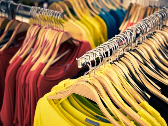 Clothing and retail store: view of clothes shop with t-shirt hanged on stand