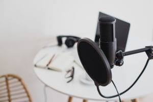Microphone in the foreground with a blurred image of table and chair behind.