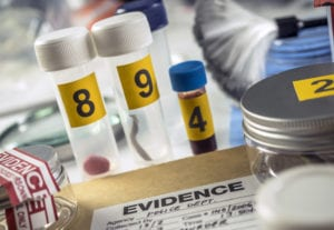Several evidence numbered next to form in scientific laboratory,